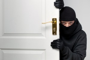 6424813-burglar-sneaking-in-a-open-house-door